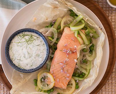 Spring Parchment Baked Salmon with Fennel Yogurt Sauce