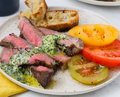 Rib-Eye Steaks with Basil Butter and Sliced Tomatoes